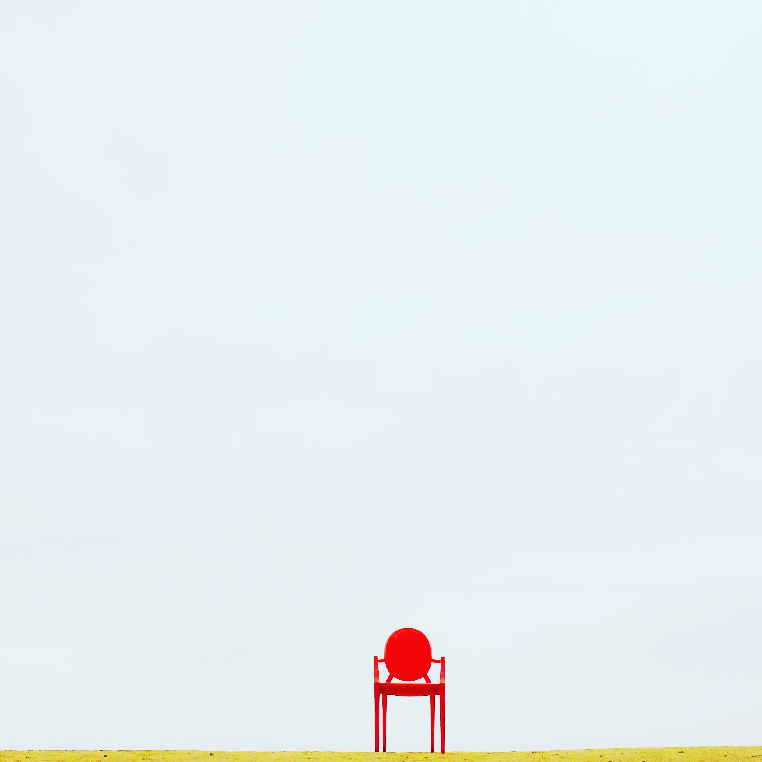 Canva - Red Armchair on Brown Surface